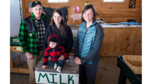 Steven Christianson, owner of Christianson Farm, LLC, in Readfield, Maine, along with his wife, Caroline and their son, Easten, with their FarmStart advisor Kathryn Bisson, from Farm Credit East's Auburn, Maine, office. (Courtesy Photo)
