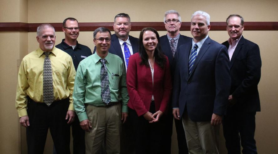 2018-2019 NAAB Board of Directors: Front Row (L to R): Christopher England, Select Sires; Earl Souva, Great Lakes Sire Service; Dr. Katie Olson, ABS Global, NAAB Board Chair; Paul Hunt, Vice Chair, Alta Genetics. Back Row (L to R): Roy Wilson, GENEX; David Jensen, 3rd member of the Executive Committee, Hawkeye Breeders Service; Jay Weiker, NAAB President; Bobby Fair, Sexing Technologies.