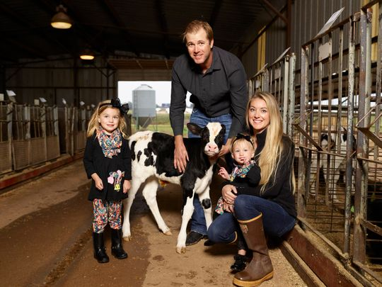 Dairy farmer and environmental scientist Tara Vander Dussen with her family on their farm, Rajen Dairy.