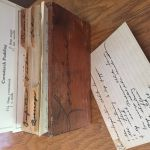 A vintage wooden recipe box with a recipe for cornstarch pudding.